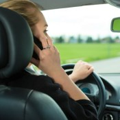 Woman driving while on cell phone
